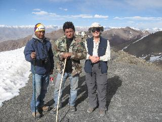 Maryann with Phuntog (guide) and another climber. The snow to our left is hip-deep. We are above Stok Kangri base camp. From here we had a view of some of the remainder of the route and Phuntog said he had never seen so much snow on the mountain.